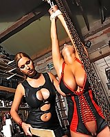 Lesbians Carol and Jannete spanking in latex